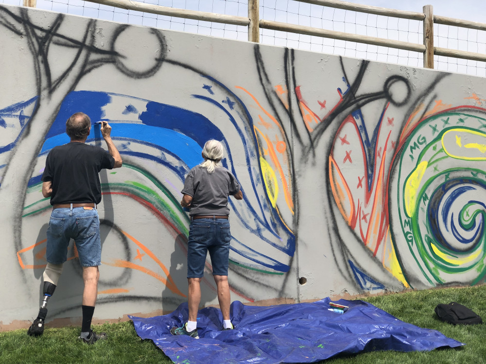 Community members painting on August 28