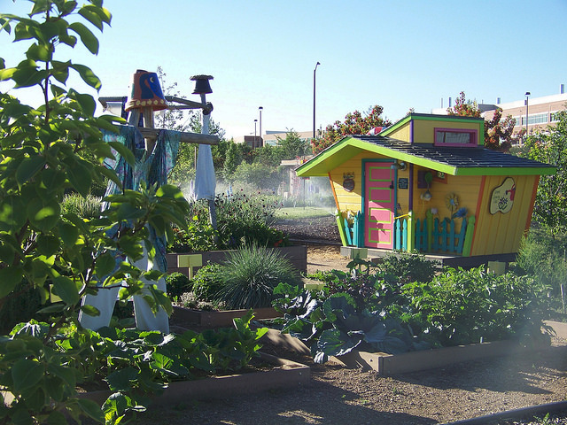 Playhouse and play area in the children's garden