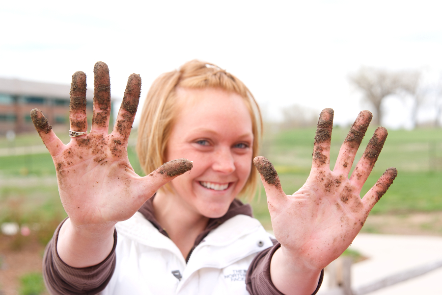 gardener with dirty hands and smile