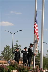 3 police officers raising a flag