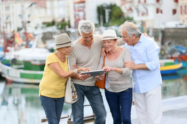 group of older people looking at map