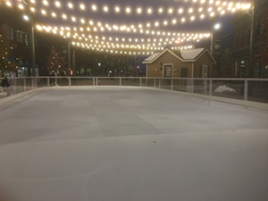 Old Town Square Skate Rink at night with string lights above