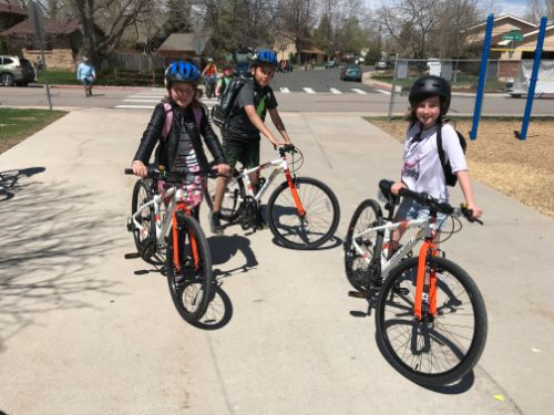 Fourth-graders riding new grant-funded bicycles