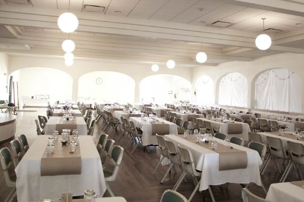 ballroom of Club Tico filled with long tables for a wedding