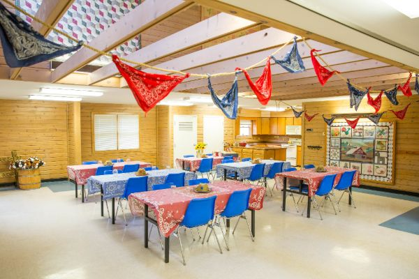 classroom set up with tables and bandanna scarves