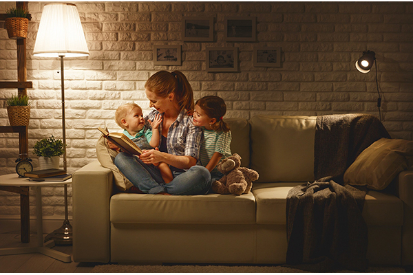 Mom and kids reading on couch